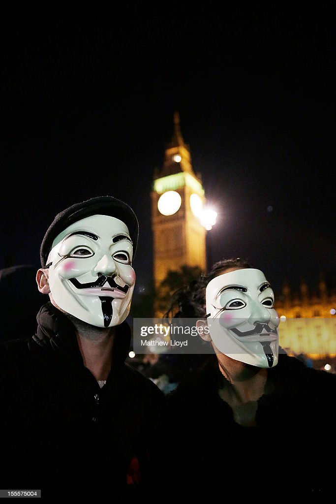 Members of the Anonymous group protest outside the Houses of Parliament n November 5, 2012 in London, England. The group wear masks inspired by a character from the film 'V for Vendetta', which culminates in the march en masse of the public against parliament, in protest against a authoritarian goverment, on the fifth of November.