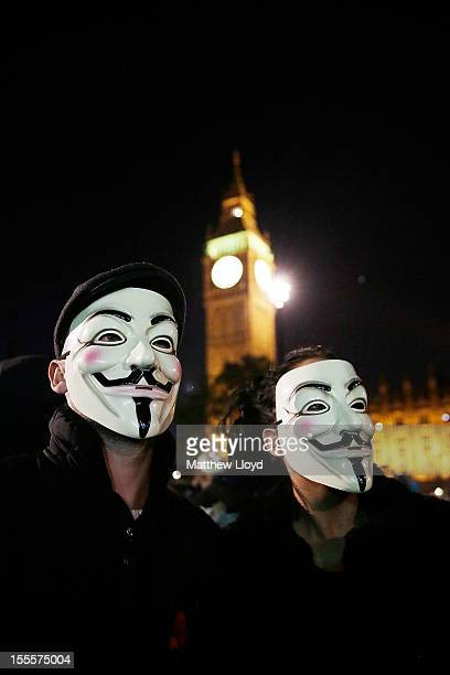 Members of the Anonymous group protest outside the Houses of Parliament n November 5 2012 in London England The group wear masks inspired by a...