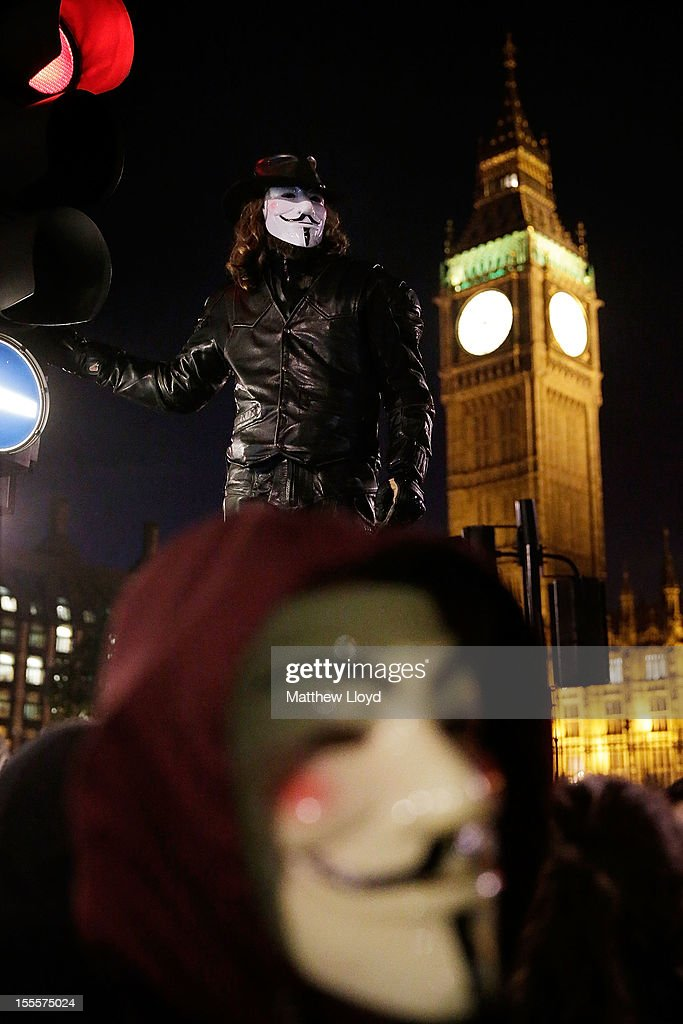 Members of the Anonymous group protest outside the Houses of Parliament on November 5, 2012 in London, England. The group wear masks inspired by a character from the film 'V for Vendetta', which culminates in the march en masse of the public against parliament, in protest against a authoritarian goverment, on the fifth of November.
