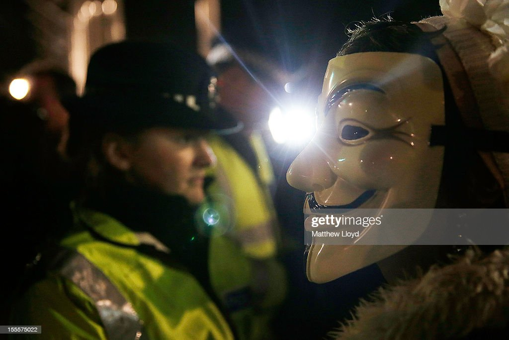 Members of the Anonymous group scuffle with police outside the Houses of Parliament on November 5, 2012 in London, England. The group wear masks inspired by a character from the film 'V for Vendetta', which culminates in the march en masse of the public against parliament, in protest against a authoritarian goverment, on the fifth of November.