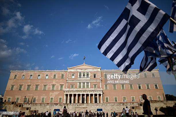 Members of the antiEuropean Greek Communist party the KKE take part a march against austerity in front of the Greek Parliament in Athens on July 10...