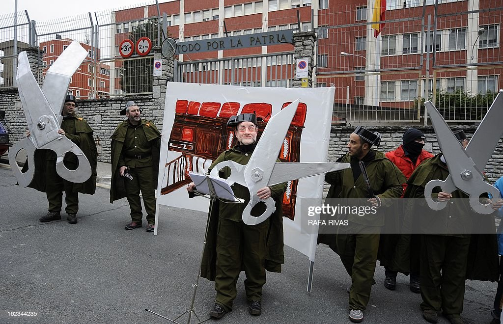 Members of the anti-military group Kakitzat wear Guardia Civil uniforms and a mask depecting Spain's Prime Minister Mariano Rajoy during a protest against government's cuts and the military expense to mark the 32nd anniversary of the attempted coup d'etat in Spain, on February 22, 2013, in the Northern Spanish Basque city of Bilbao.
