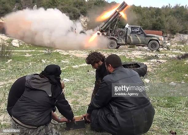 Members of the antiregimist Ahrar alSham brigade launch 'Grad missiles' during an operation against Syrian Regime forces deployed in the Latakia from...