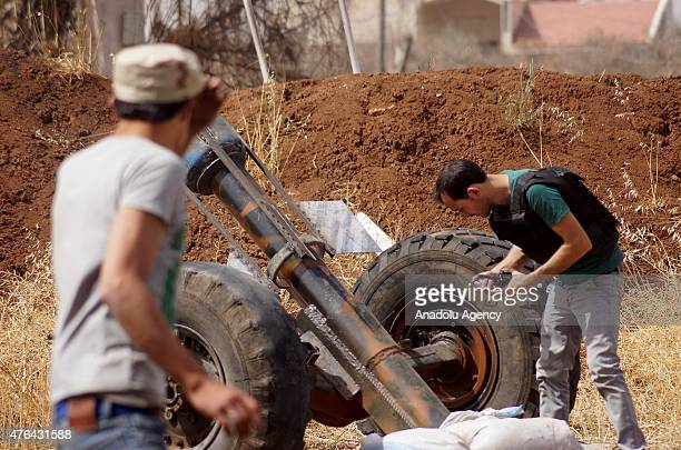 Members of the antiregimist opposition forces make preparations before they attack to the areas under the control of Syrian regime forces deployed at...