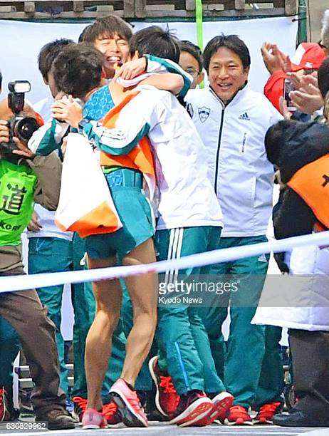Members of the Aoyama Gakuin University TokyoHakone collegiate ekiden road relay team celebrate on Jan 3 in Tokyo after winning the twoday race for a...