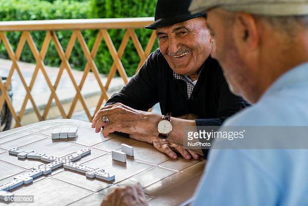 Members of the Aqsaqal club play dominoes at the area of the club in Qrmz Qsb or Red Town Quba district of Azerbaijan on 28 September 2016 Qrmz Qsb...