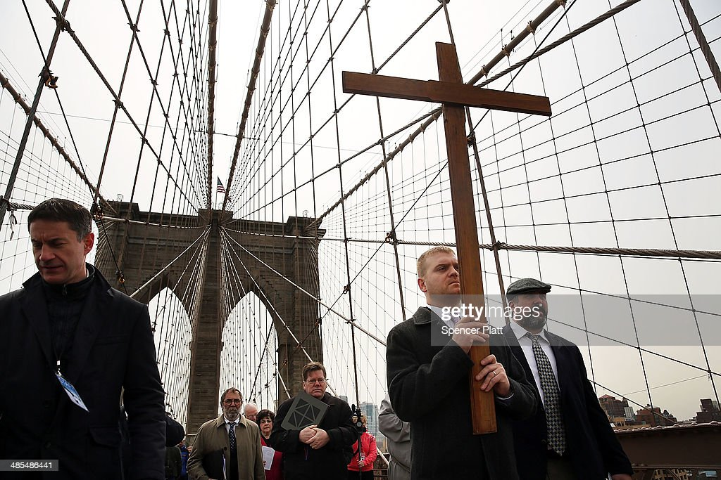 Members of the Archdiocese of New York and the Diocese of Brooklyn lead the Way of the Cross procession of hundreds over the Brooklyn Bridge on April 18, 2014 in New York City. The Way of the Cross is a traditional Catholic procession recalling the suffering and death of Jesus Christ and often includes Gospel readings, choral music and readings at stations along the way. This is 19th anniversary of the procession across the iconic bridge.