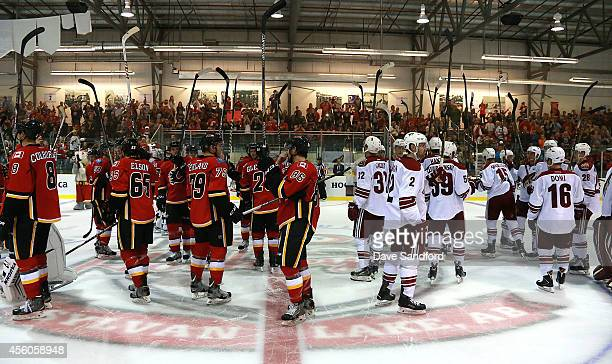 Members of the Arizona Coyotes and the Phoenix Coyotes salute the crowd after the game during Day 4 of NHL Kraft Hockeyville at the Sylvan Lake...