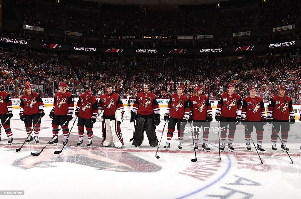 Members of the Arizona Coyotes stand on the blue line during pregame introductions prior to the start of a game against the Philadelphia Flyers at Gila River Arena on October 15, 2016 in Glendale, Arizona.