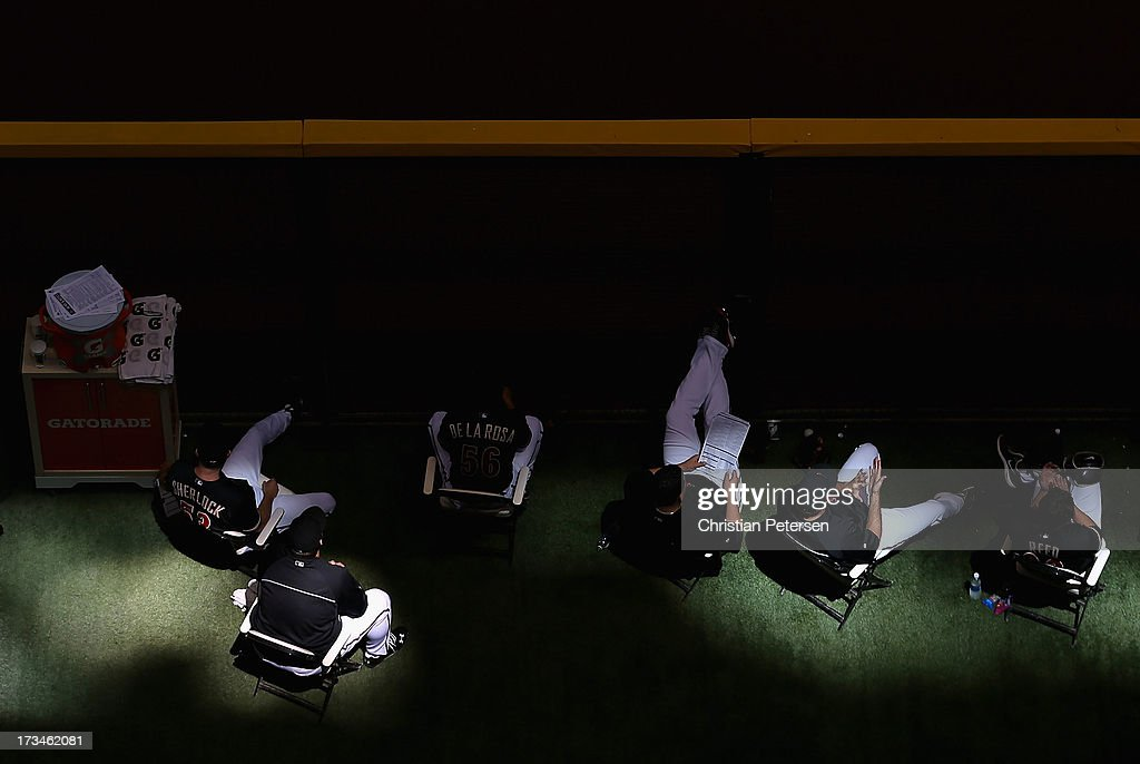 Members of the Arizona Diamondbacks watch from the bullpen during the MLB game against the Milwaukee Brewers at Chase Field on July 14, 2013 in Phoenix, Arizona. The Brewers defeated the Diamondbacks 5-1.