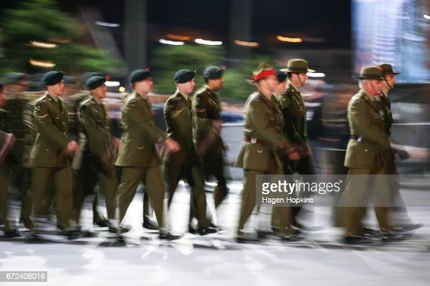 Members of the armed forces march during Anzac Day dawn service at Pukeahu National War Memorial Park on April 25 2017 in Wellington New Zealand In...