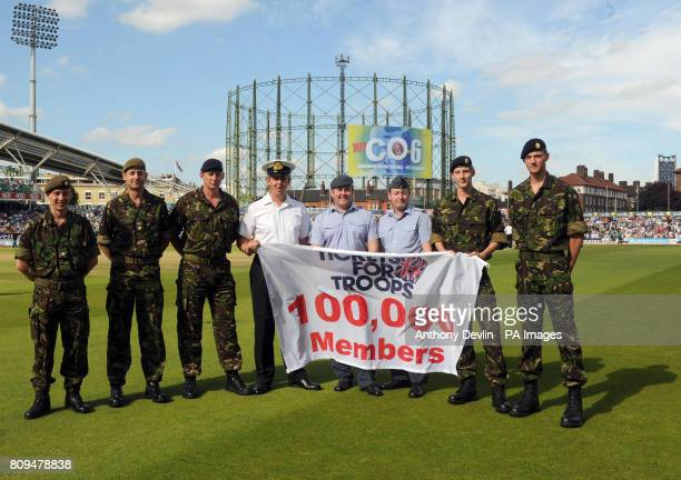 Members of the armed forces pose on the pitch during the tea interval during the npower Fourth Test at The Kia Oval London