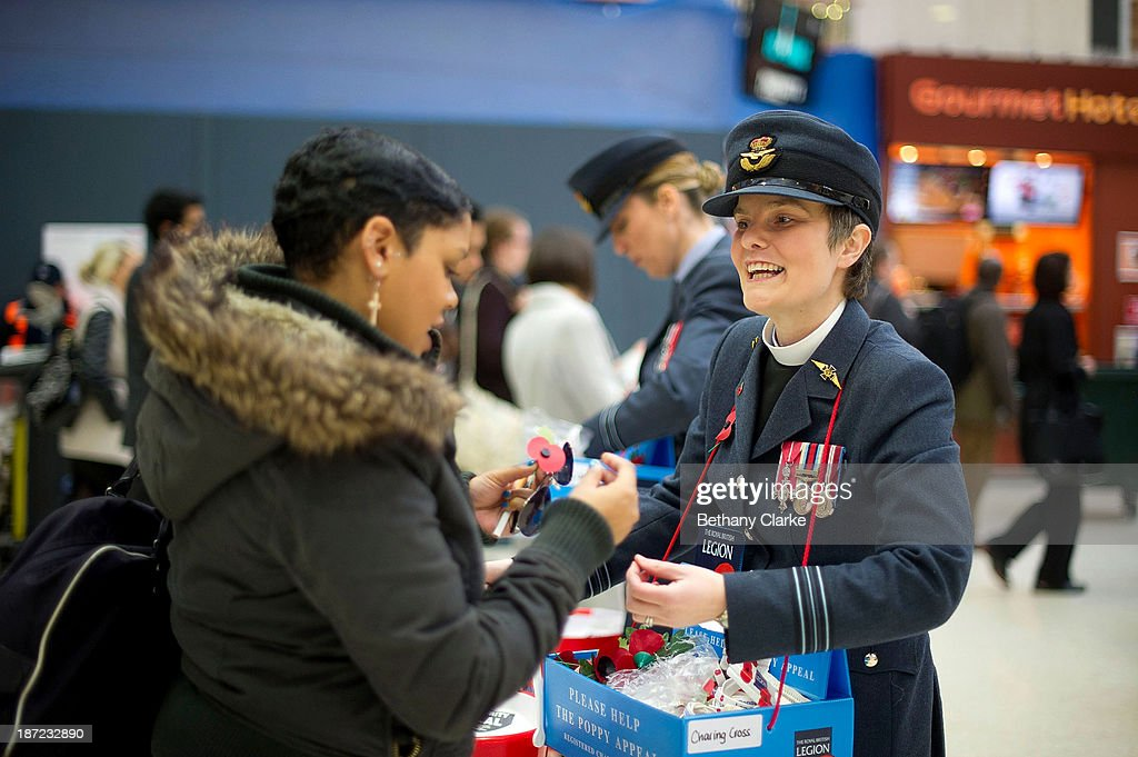Members of the Armed Forces sell poppies at Charing Cross station on November 7, 2013 in London, England. The London Poppy Day appeal aims to raise more than £1mIllion in one day.