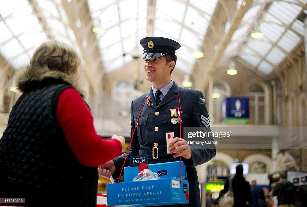 Members of the Armed Forces sell poppies at Charing Cross station on November 7, 2013 in London, England. The London Poppy Day appeal aims to raise more than £1miIlion in one day.