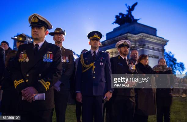 Members of the armed forces watch an Anzac Day dawn service at the Australian War Memorial at Hyde Park Corner on April 25 2017 in London England The...