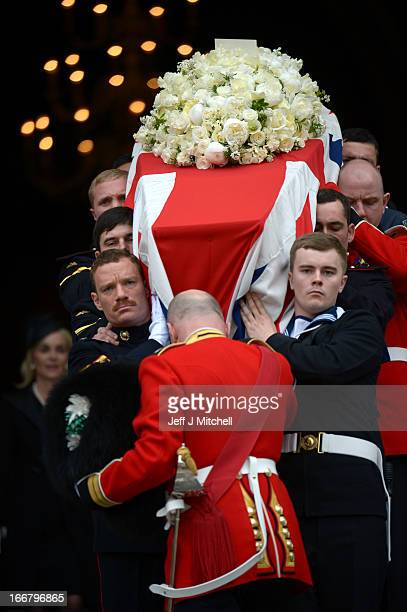 Members of the Armed Services carry the coffin down the steps after the Ceremonial funeral of former British Prime Minister Baroness Thatcher at St...