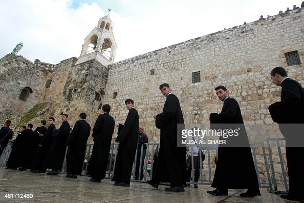 Members of the Armenian clergy parade at Manger Square outside the Church of the Nativity during the Armenian Christmas celebrations in the biblical...