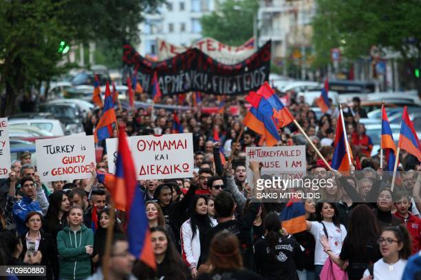 Members of the Armenian community hold Armenian flags and placards during a gathering to commemorate the 100th anniversary of the Armenian genocide...