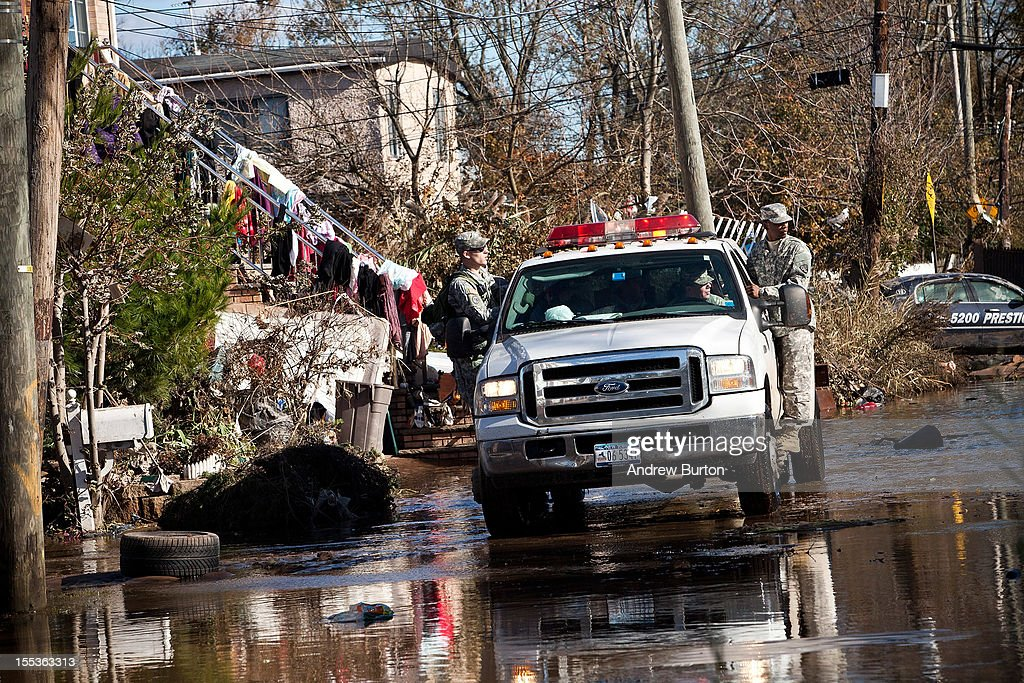 Members of the Army National Guard patrol the Midland Beach neighborhood of Staten Island on November 3, 2012 in New York City. As clean up efforts from Superstorm Sandy continue, colder weather and another storm predicted for next week are beginning to make some worried.