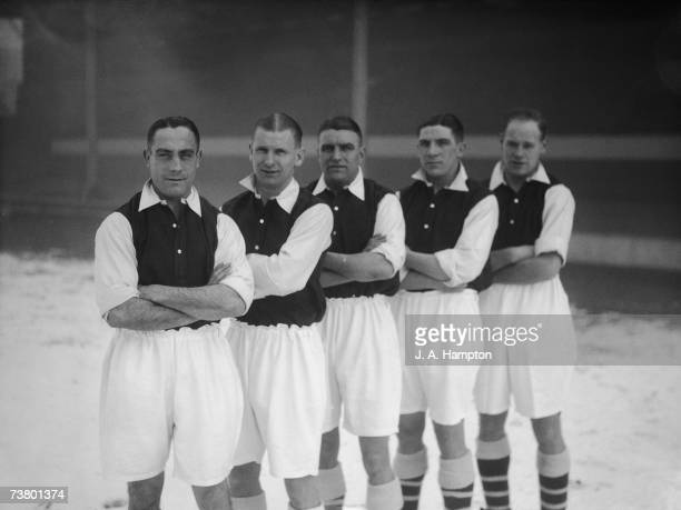Members of the Arsenal FC team who have been selected to play for England against Ireland in the next international match standing in the snow at the...