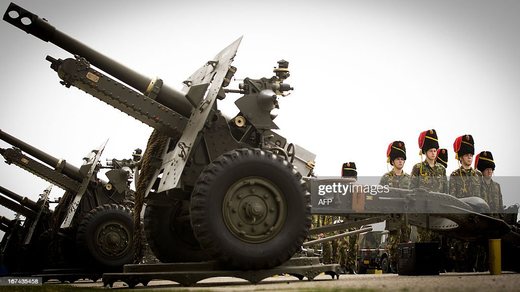 Members of the artillery stand as they rehearse during a practice in 't Harde, The Netherlands, on April 25, 2013. During the abdication of Queen Beatrix and the enthronement of Prince Willem-Alexander on April 30, the artillery will fire a gun salute. netherlands out