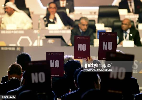 Members of the Asian Football Confederation hold up 'NO' voting cards during the AFC Extraordinary Congress in Goa on September 27 2016 An Asian...