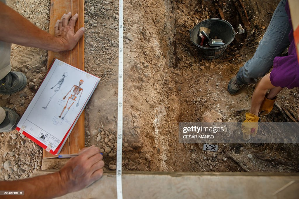 Members of the Association for the Recovery of Historical Memory of Valladolid do exhumation works in a mass grave from the Spanish civil war where...