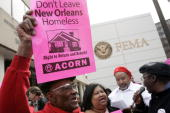 Members of the Association of Community Organizations for Reform Now shout slogans during a rally outside FEMA's headquarters March 12 2007 in...