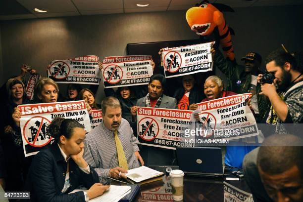Members of the Association of Community Organizations for Reform Now disrupt a public auction of a foreclosed home in Washington on February 10 2009...