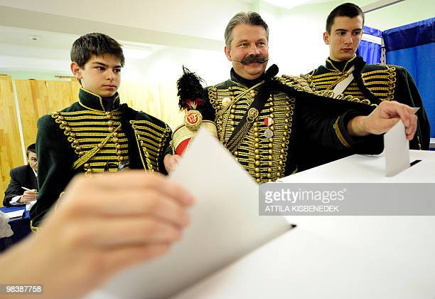 Members of the Association of Cultural Preservation for Hungarian Hussar Unit the Vencel family Levente Vencel and Mate wear period costumes of the...