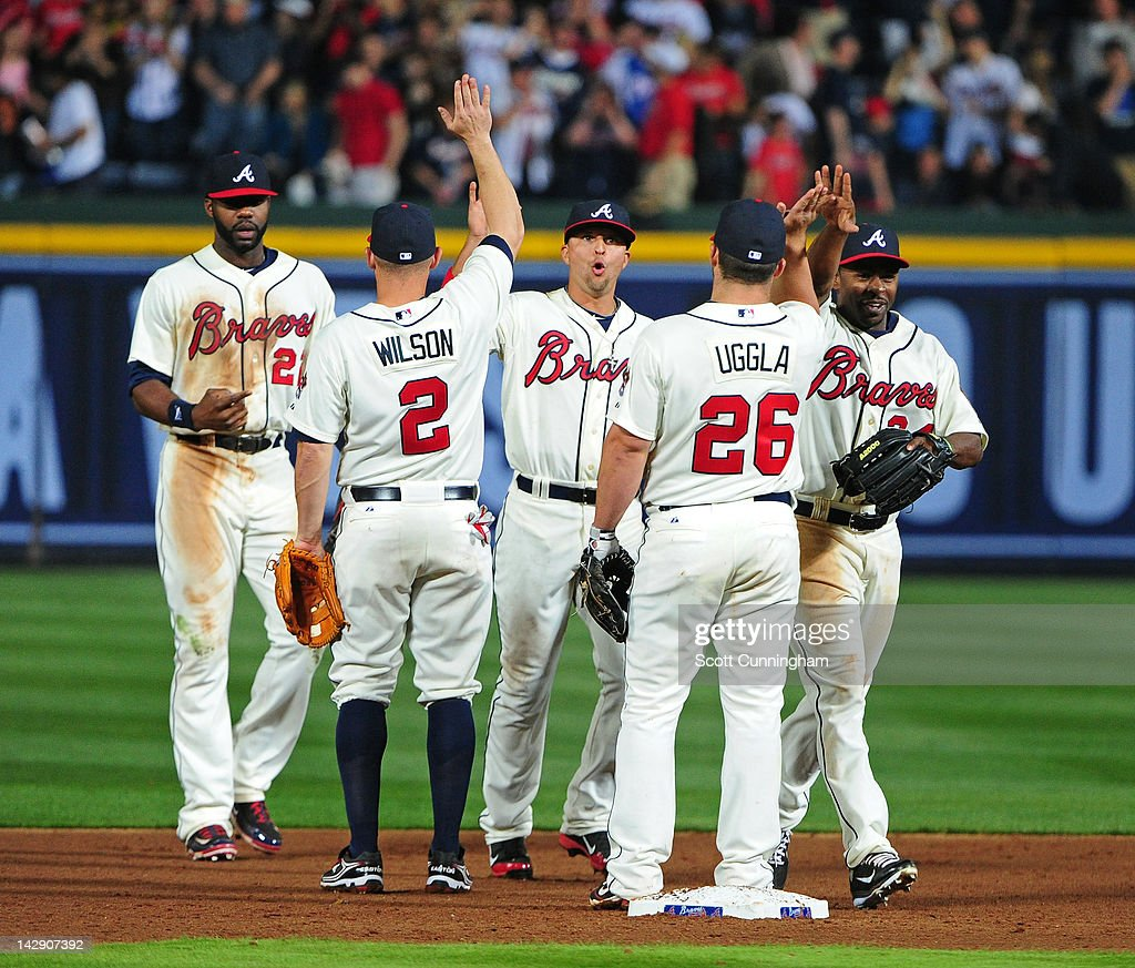Members of the Atlanta Braves celebrate after the game against the Milwaukee Brewers at Turner Field on April 14, 2012 in Atlanta, Georgia.