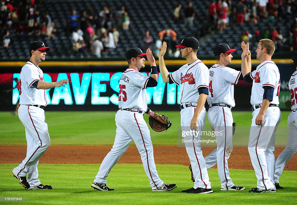 Members of the Atlanta Braves celebrate after the game against the Colorado Rockies at Turner Field on July 31, 2013 in Atlanta, Georgia.