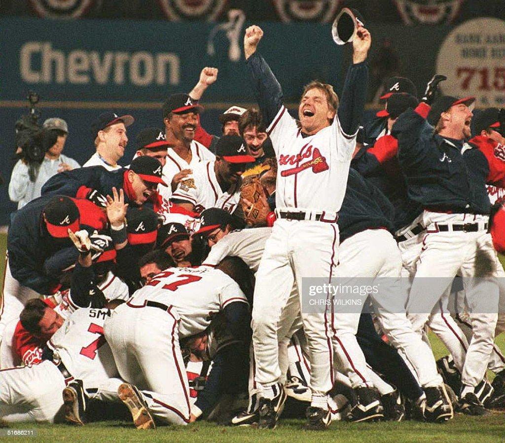 Members of the Atlanta Braves celebrate winning their first World Series at Atlanta's Fulton County Stadium 28 October David Justice's home run won...