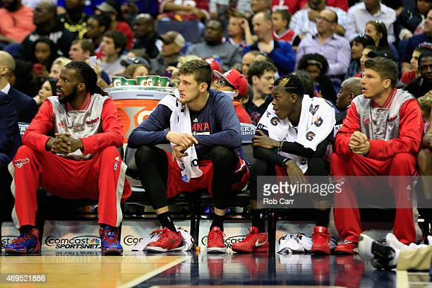 Members of the Atlanta Hawks bench look on during the second half of their 10899 loss to the Washington Wizards at Verizon Center on April 12 2015 in...