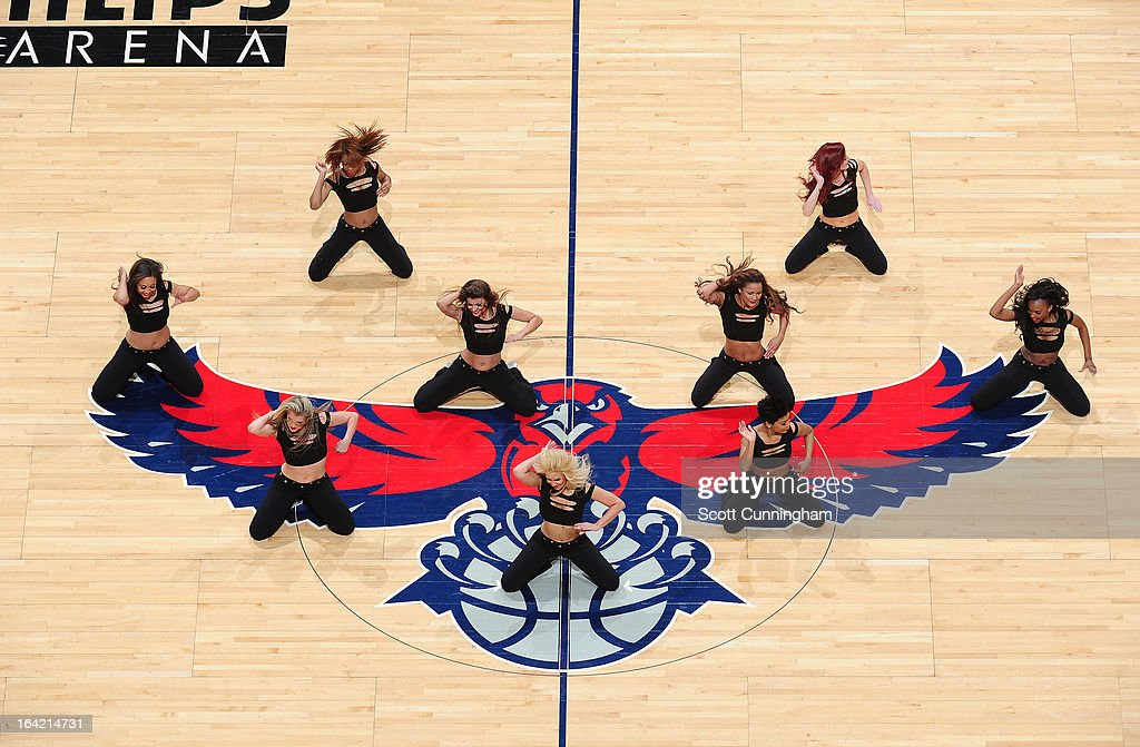 Members of the Atlanta Hawks Dance Team get the crowd excited against the Milwaukee Bucks on March 20 2013 at Philips Arena in Atlanta Georgia NOTE...