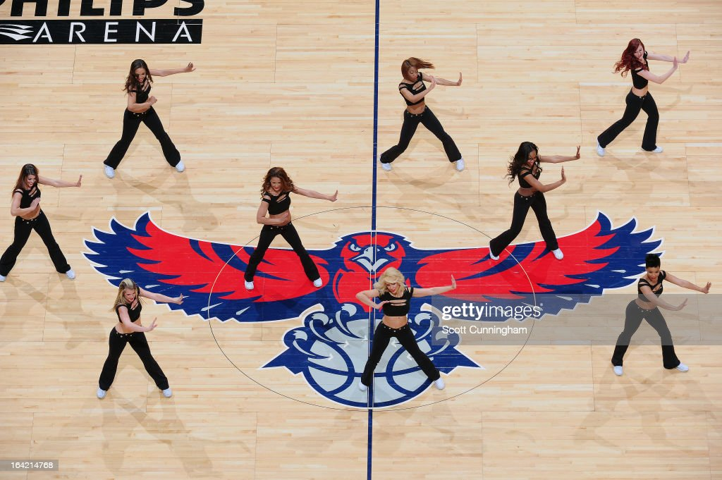 Members of the Atlanta Hawks Dance Team get the crowd pumped up against the Milwaukee Bucks on March 20, 2013 at Philips Arena in Atlanta, Georgia.