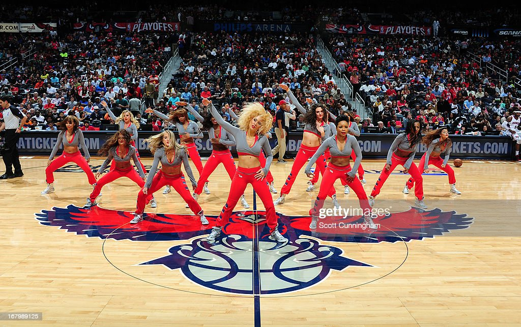 Members of the Atlanta Hawks Dance Team get the crowd pumped up against the Indiana Pacers during Game Six of the Eastern Conference Quarterfinals in the 2013 NBA Playoffs on May 3, 2013 at Philips Arena in Atlanta, Georgia.