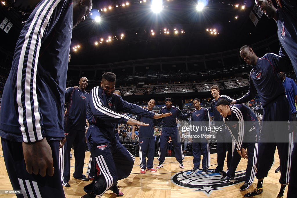 Members of the Atlanta Hawks get pumped up prior to the game against the Orlando Magic on February 13, 2013 at Amway Center in Orlando, Florida.