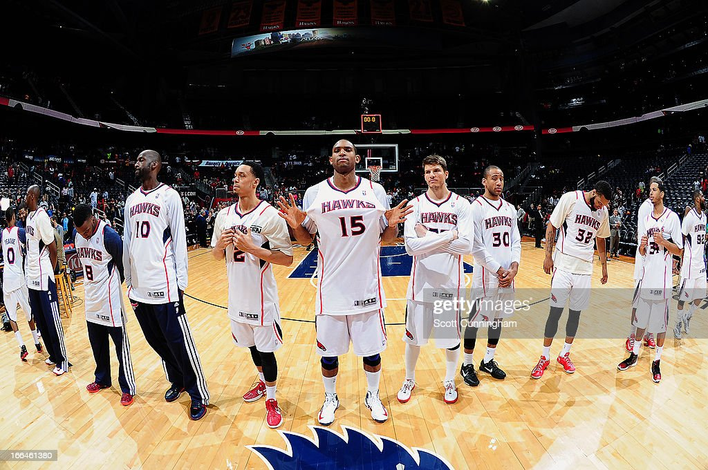 Members of the Atlanta Hawks line-up after the game to give fans their game used jerseys on April 12, 2013 at Philips Arena in Atlanta, Georgia.
