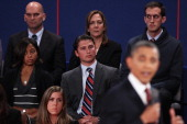 Members of the audience listen to US President Barack Obama answer questions during a town hall style debate at Hofstra University October 16 2012 in...