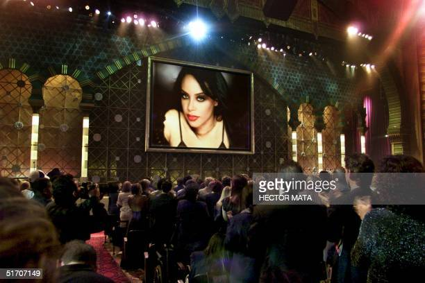Members of the audience rise upon the appearance of an image of the late singer Aaliyah who was posthumously awarded the Soul/RB Favorite Female...