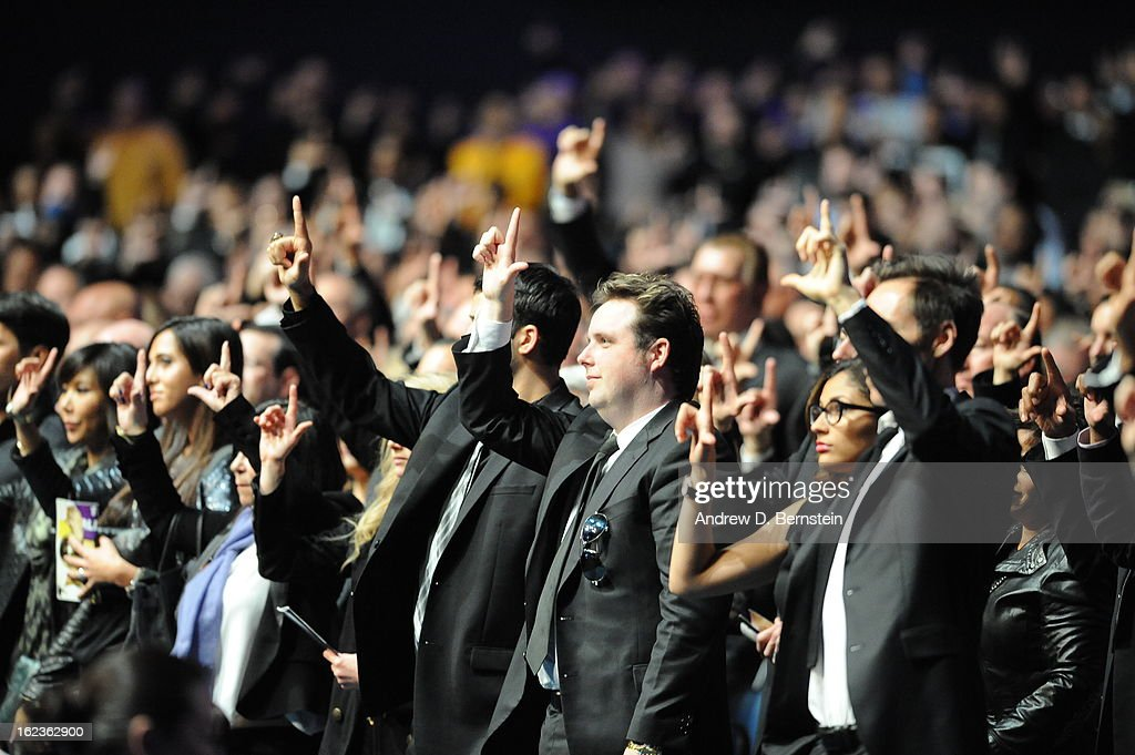 Members of the audience stand during the memorial service for Los Angeles Lakers Owner Dr. Jerry Buss at Nokia Theatre LA LIVE on February 21, 2013 in Los Angeles, California.