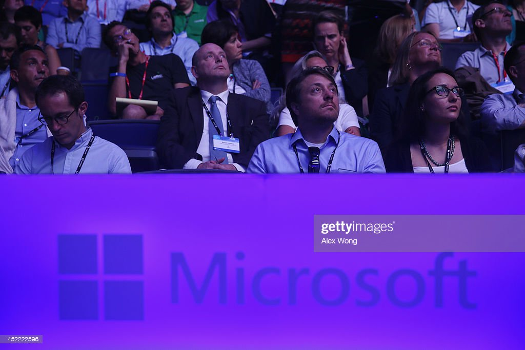 Members of the audience watch a video during the 2014 Microsoft Worldwide Partner Conference July 16, 2014 in Washington, DC. Microsoft CEO Satya Nadella delivers keynote remarks on 'his vision for our joint success in a mobile-first, cloud-first world' during the annual event.