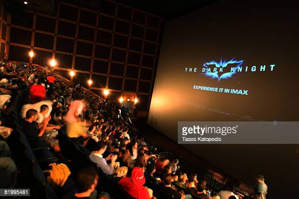 Members of the audience watch the 'The Dark Knight' Chicago midnight screening at the Navy Pier Imax Theater on July 17 2008 in Chicago Illinois