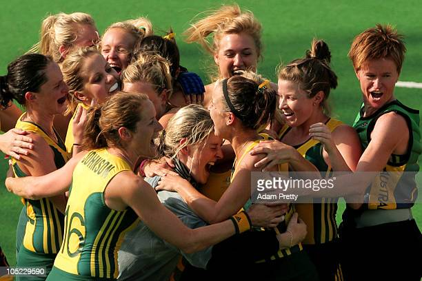 Members of the Australia team congratulate goalkeeper Rachael Lynch as they celebrate claiming gold in the women's finals gold medal match between...