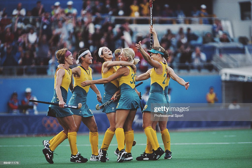 Members Of The Australia Womens Field Hockey Team Celebrate After Scoring A Goal In Their Medal