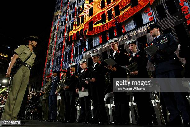 Members of the Australian and New Zealand Defence Forces stand during dawn service at Martin Place on April 25 2015 in Sydney Australia Australians...