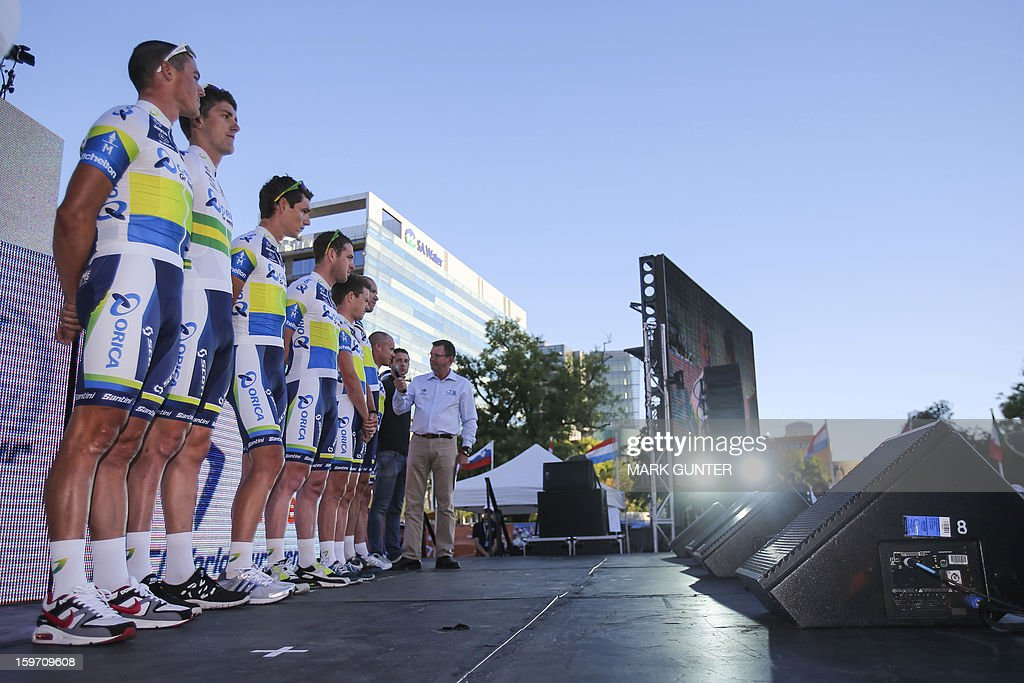 Members of the Australian cycling team GreenEdge take to the stage during the team presentations prior to the Tour Down Under in Adelaide on January 19, 2013. The six-stage Tour Down Under takes place from January 20 to 27. AFP PHOTO / Mark Gunter USE