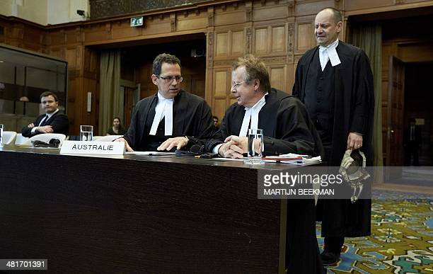 Members of the Australian delegation Justin Gleeson Bill Campbell and Philippe Sands speak prior to the verdict in the case against Japanese whaling...