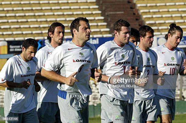 Members of the Australian football team jog during a training session 11 November 2005 at the Centenario Stadium in Montevideo where tomorrow the...